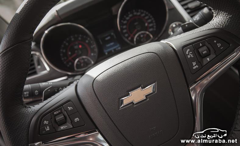 2014-chevrolet-ss-steering-wheel-mounted-controls-and-badge-photo-553807-s-787x481