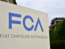 A picture shows the Fiat Chrysler Automobiles (FCA) logo at the entrance of the headquarters, on April 19, 2015 in Turin. AFP PHOTO / GIUSEPPE CACACE        (Photo credit should read GIUSEPPE CACACE/AFP/Getty Images)