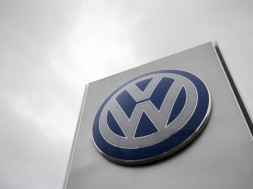 A VW sign is seen outside a Volkswagen dealership in London