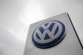 A VW sign is seen outside a Volkswagen dealership in London
