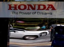 A man is reflected on a window at Honda Motor's showroom in Tokyo, Japan, May 13, 2016.   REUTERS/Toru Hanai/File Photo