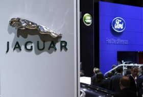 Logos of the carmakers Jaguar, Land Rover and Ford are pictured during the first media day of the 78th Geneva Car Show at the Palexpo in Geneva